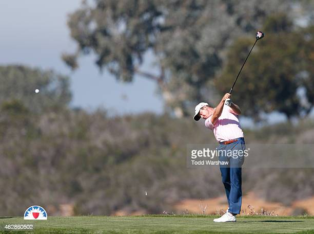 Harris English plays his tee shot on the ninth hole of the north course during round two of the Farmers Insurance Open at Torrey Pines Golf Course on...