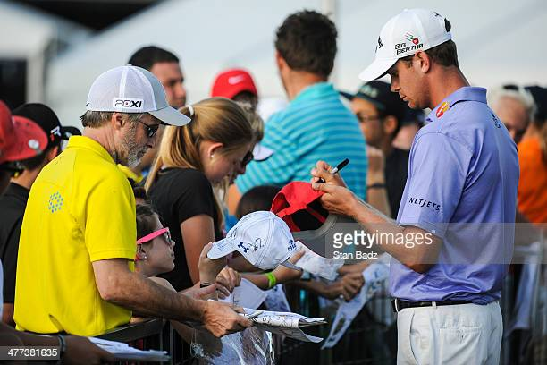 Harris English signs autographs for fans after completing the third round of the World Golf ChampionshipsCadillac Championship at Blue Monster Trump...