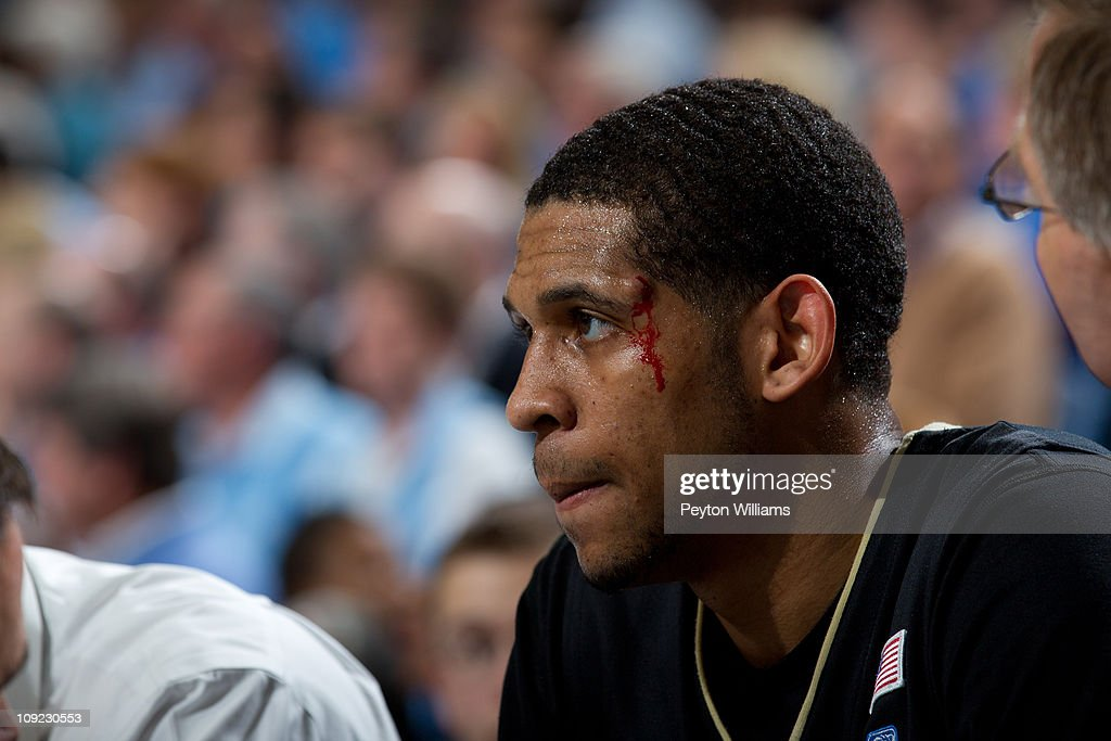 C.J. Harris #11 of the Wake Forest Demon Deacons bleeds out above his eye after hitting the court while playing the North Carolina Tar Heels at the Dean E. Smith Center in Chapel Hill, North Carolina. North Carolina won 64-78.