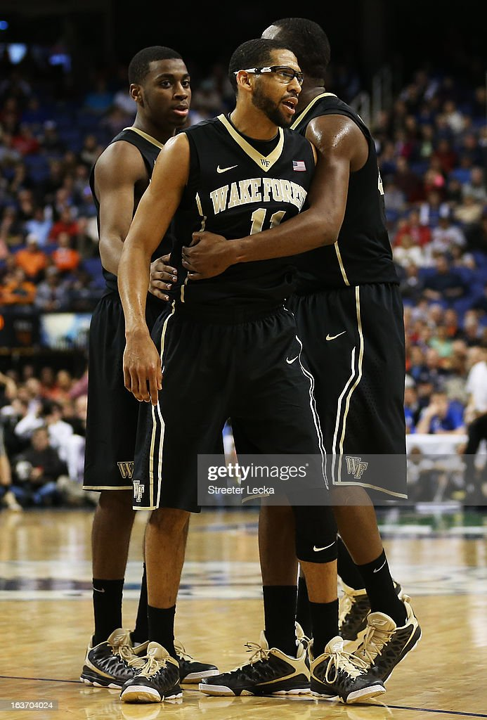 C.J. Harris #11 of the Wake Forest Demon Deacons reacts with teammates in the second half of their game against the Maryland Terrapins during the first round of the Men's ACC Basketball Tournament at Greensboro Coliseum on March 14, 2013 in Greensboro, North Carolina.