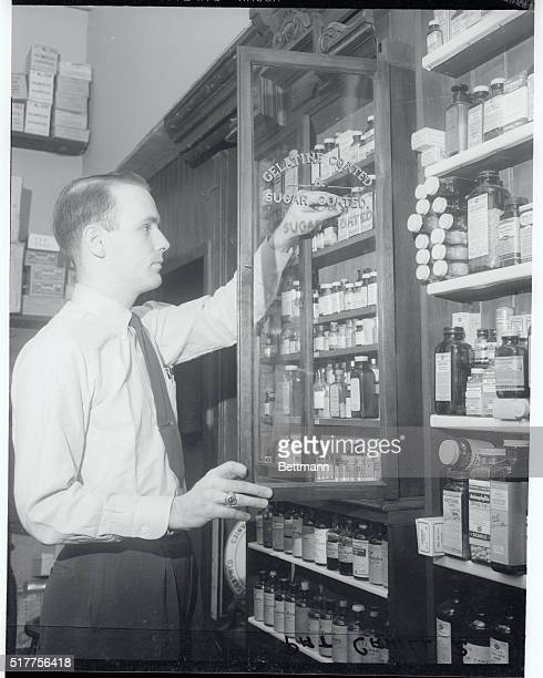 John W Porr Jr uses the 65yearold drug cabinet purchased by his grandfather in 1888 when the store opened here at that time when a druggist purchased...