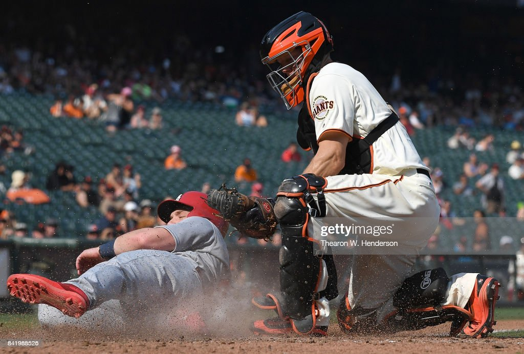 Harrison Bader #48 of the St. Louis Cardinals is tagged out at home plate by Nick Hundley #5 of the San Francisco Giants in the top of the tenth inning at AT&T Park on September 2, 2017 in San Francisco, California.