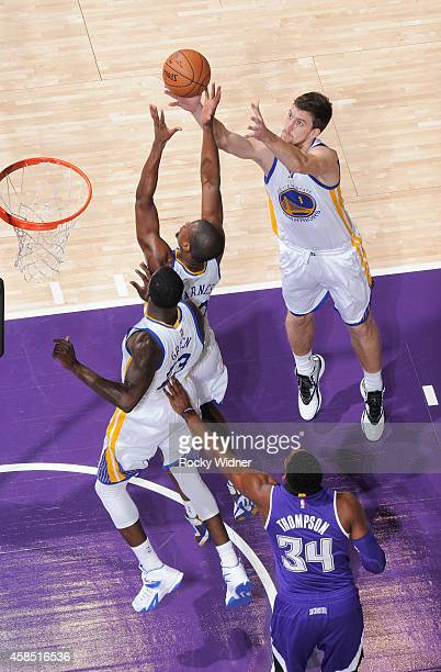 Harrison Barnes and Ognjen Kuzmic of the Golden State Warriors rebound against the Sacramento Kings on October 29 2014 at Sleep Train Arena in...