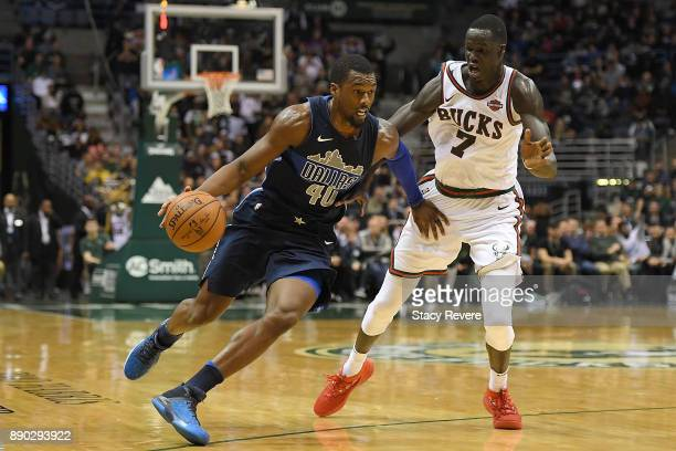 Harrison Barnes of the Dallas Mavericks drives around Thon Maker of the Milwaukee Bucks during a game at the Bradley Center on December 8 2017 in...