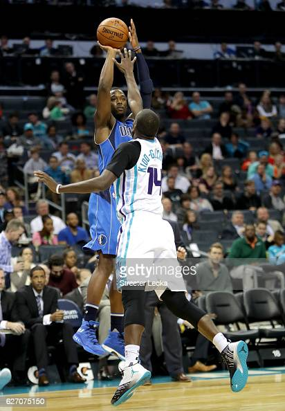 Harrison Barnes of the Dallas Mavericks shoots over Michael KiddGilchrist of the Charlotte Hornets during their game at Spectrum Center on December 1...