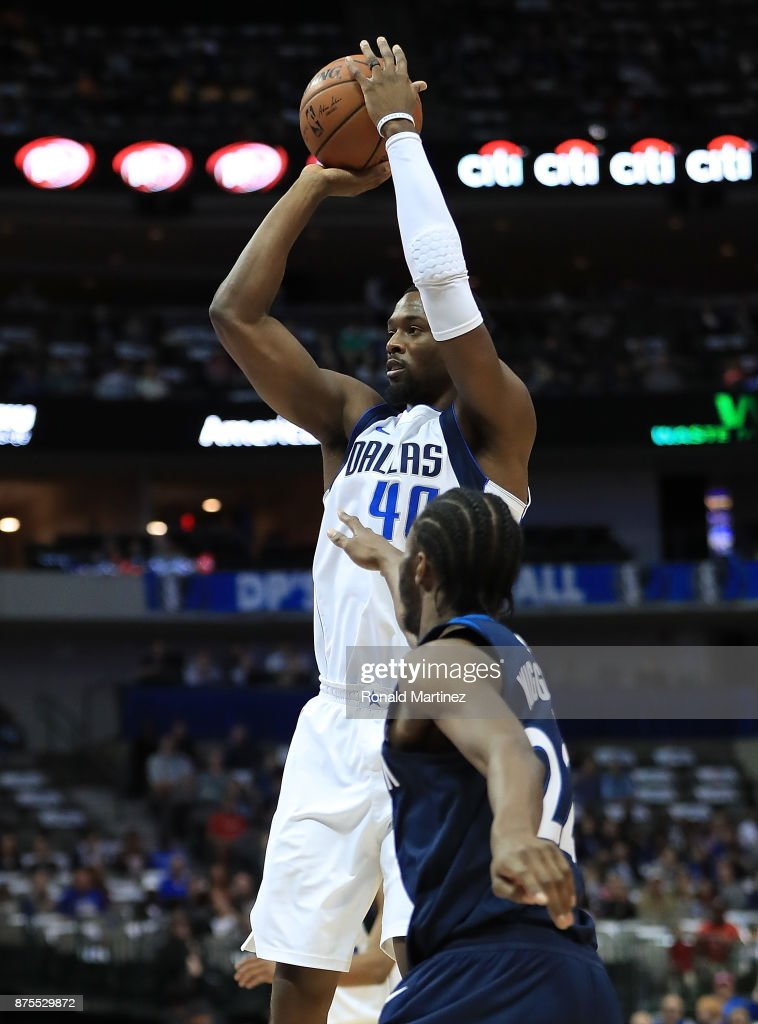 Harrison Barnes #40 of the Dallas Mavericks takes a shot against Andrew Wiggins #22 of the Minnesota Timberwolves at American Airlines Center on November 17, 2017 in Dallas, Texas.