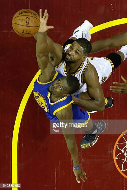 Harrison Barnes of the Golden State Warriors and Tristan Thompson of the Cleveland Cavaliers battle for the ball during the first half in Game 6 of...