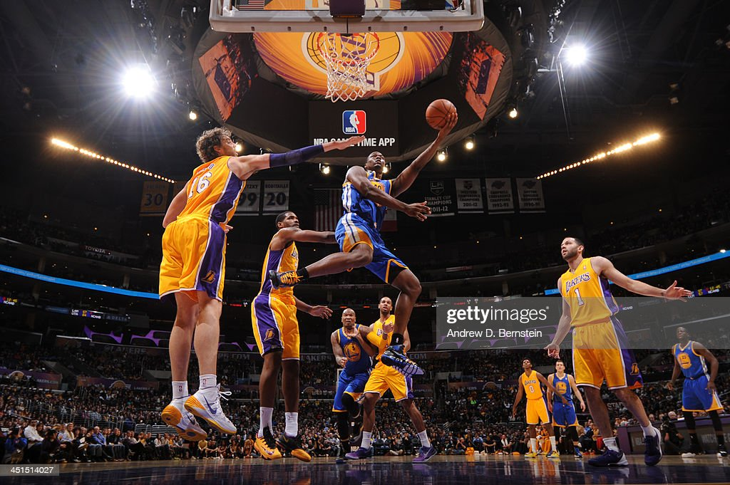 <a gi-track='captionPersonalityLinkClicked' href=/galleries/search?phrase=Harrison+Barnes&family=editorial&specificpeople=6893973 ng-click='$event.stopPropagation()'>Harrison Barnes</a> #40 of the Golden State Warriors attempts a shot against <a gi-track='captionPersonalityLinkClicked' href=/galleries/search?phrase=Pau+Gasol&family=editorial&specificpeople=201587 ng-click='$event.stopPropagation()'>Pau Gasol</a> #16 of the Los Angeles Lakers on November 22, 2013 at STAPLES Center in Los Angeles, California.