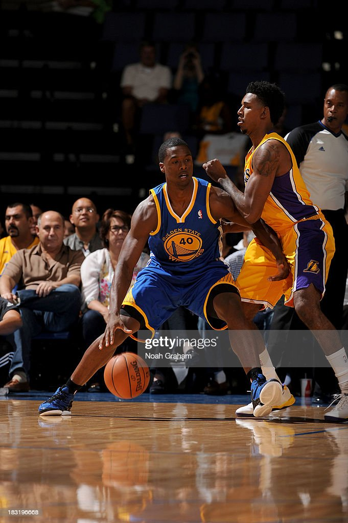 Harrison Barnes #40 of the Golden State Warriors backs down Nick Young #0 of the Los Angeles Lakers at Citizens Business Bank Arena on October 5, 2013 in Ontario, California.