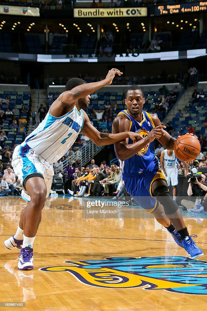 Harrison Barnes #40 of the Golden State Warriors drives against Darius Miller #2 of the New Orleans Hornets on March 18, 2013 at the New Orleans Arena in New Orleans, Louisiana.