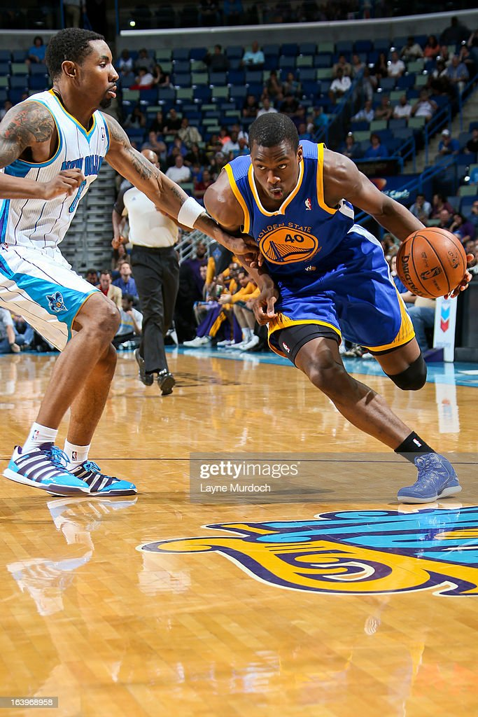 Harrison Barnes #40 of the Golden State Warriors drives against Roger Mason Jr. #8 of the New Orleans Hornets on March 18, 2013 at the New Orleans Arena in New Orleans, Louisiana.