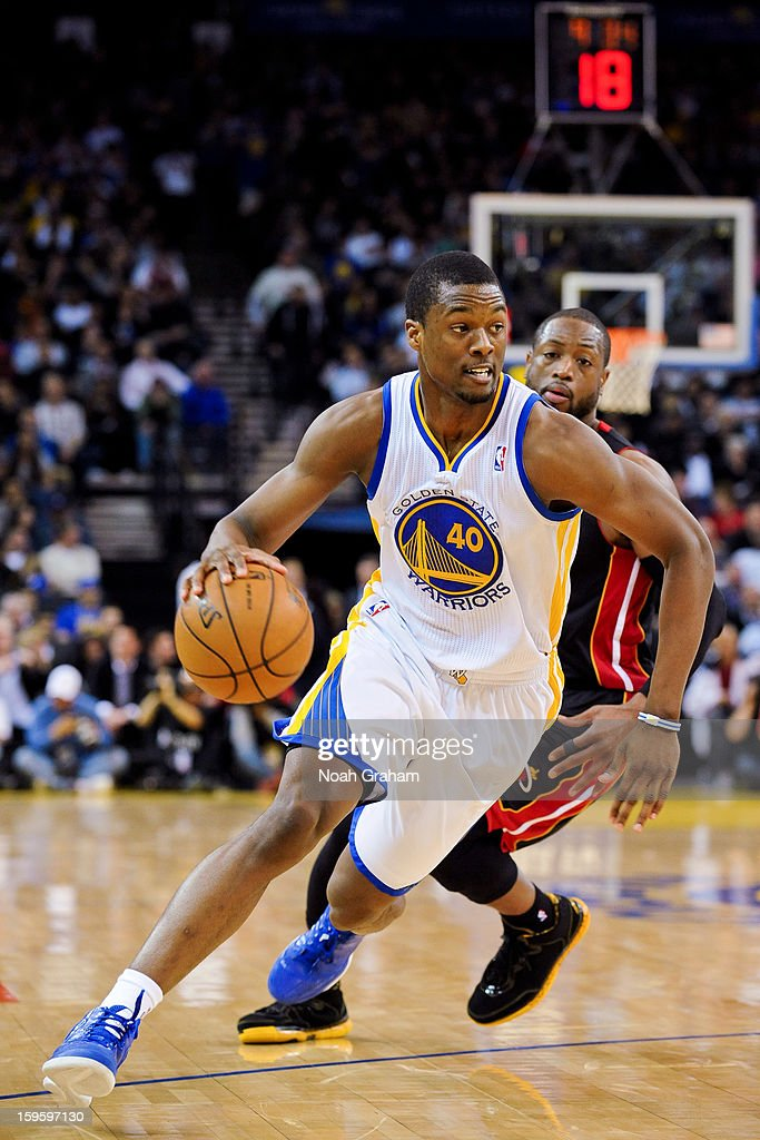 Harrison Barnes #40 of the Golden State Warriors drives ahead of Dwyane Wade #3 of the Miami Heat on January 16, 2013 at Oracle Arena in Oakland, California.