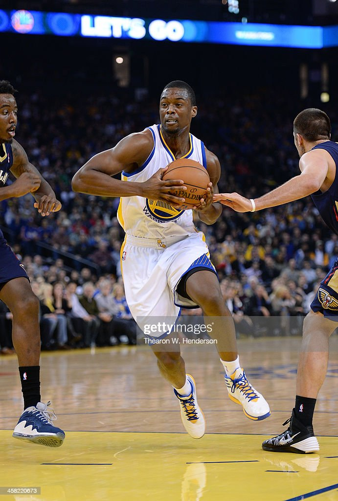 Harrison Barnes #40 of the Golden State Warriors drives on Al-Farouq Aminu #0 of the New Orleans Pelicans at ORACLE Arena on December 17, 2013 in Oakland, California.