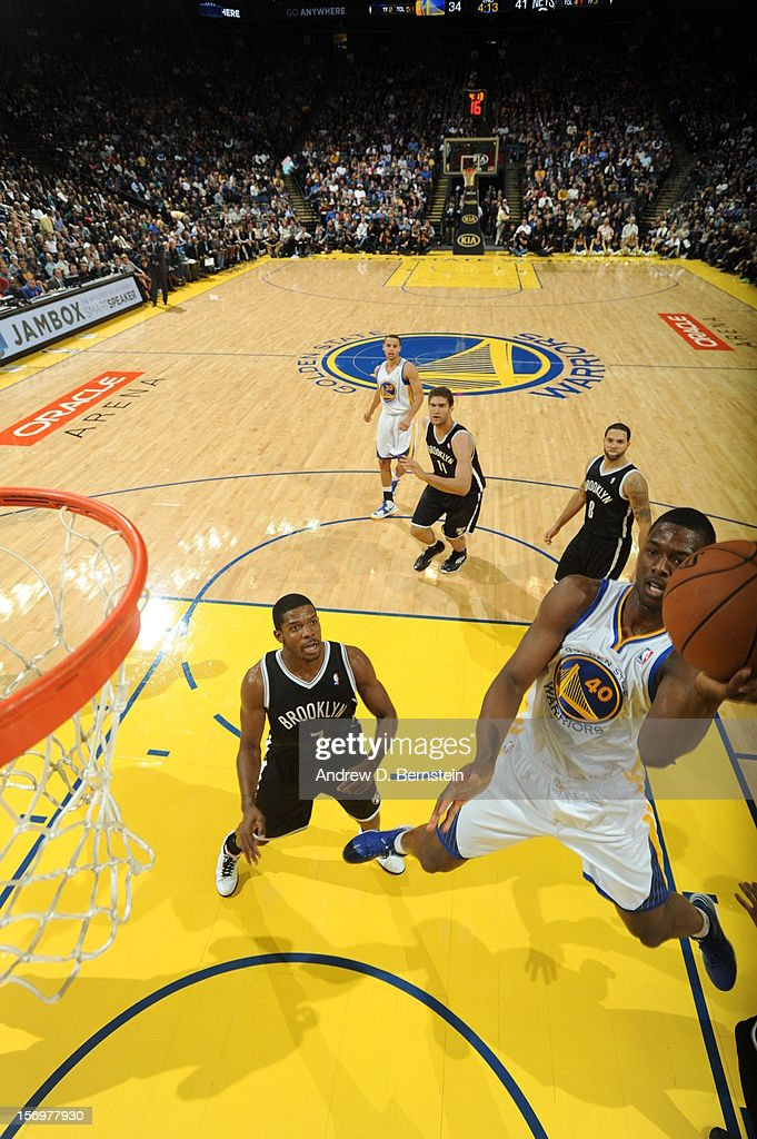 <a gi-track='captionPersonalityLinkClicked' href=/galleries/search?phrase=Harrison+Barnes&family=editorial&specificpeople=6893973 ng-click='$event.stopPropagation()'>Harrison Barnes</a> #40 of the Golden State Warriors drives to the basket past <a gi-track='captionPersonalityLinkClicked' href=/galleries/search?phrase=Joe+Johnson+-+Basketball+Player&family=editorial&specificpeople=201652 ng-click='$event.stopPropagation()'>Joe Johnson</a> #7 of the Brooklyn Nets at Oracle Arena on November 21, 2012 in Oakland, California.
