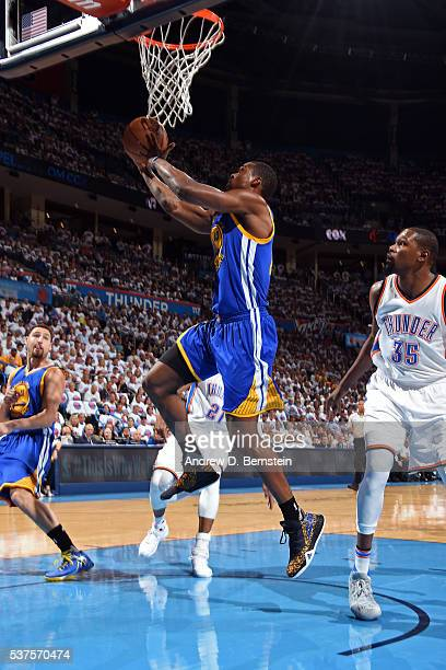 Harrison Barnes of the Golden State Warriors drives to the basket against the Oklahoma City Thunder in Game Four of the Western Conference Finals...