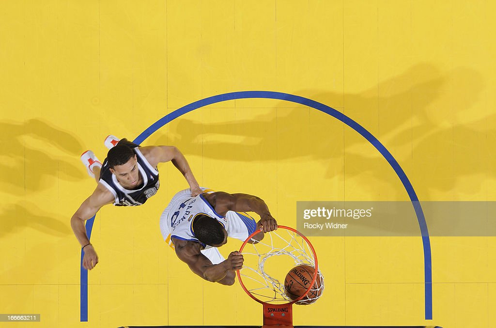 <a gi-track='captionPersonalityLinkClicked' href=/galleries/search?phrase=Harrison+Barnes&family=editorial&specificpeople=6893973 ng-click='$event.stopPropagation()'>Harrison Barnes</a> #40 of the Golden State Warriors dunks against <a gi-track='captionPersonalityLinkClicked' href=/galleries/search?phrase=Kevin+Martin+-+Basketball+Player&family=editorial&specificpeople=204503 ng-click='$event.stopPropagation()'>Kevin Martin</a> #12 of the Oklahoma City Thunder on April 11, 2013 at Oracle Arena in Oakland, California.
