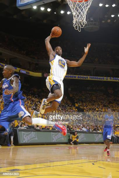 Harrison Barnes of the Golden State Warriors dunks against the Los Angeles Clippers in Game Three of the Western Conference Quarterfinals during the...