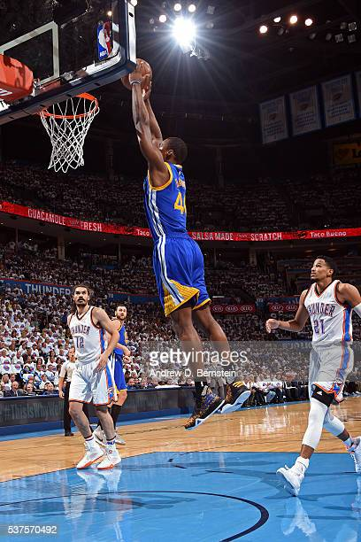 Harrison Barnes of the Golden State Warriors dunks the ball against the Oklahoma City Thunder in Game Four of the Western Conference Finals during...