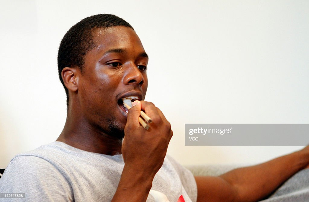 Harrison Barnes of the Golden State Warriors enjoys Chinese cuisine as he visits a fan's home on August 6, 2013 in Shanghai, China.