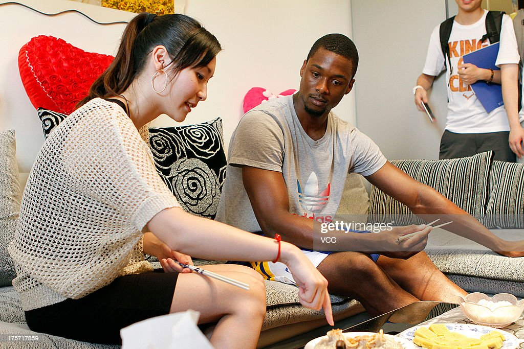 <a gi-track='captionPersonalityLinkClicked' href=/galleries/search?phrase=Harrison+Barnes&family=editorial&specificpeople=6893973 ng-click='$event.stopPropagation()'>Harrison Barnes</a> of the Golden State Warriors enjoys Chinese cuisine as he visits a fan's home on August 6, 2013 in Shanghai, China.