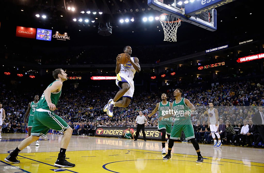 Harrison Barnes #40 of the Golden State Warriors gets a rebound and puts it back in for a basket while Tyler Zeller #44, James Young #13 and Phil Pressey #26 of the Boston Celtics look on at ORACLE Arena on January 25, 2015 in Oakland, California.