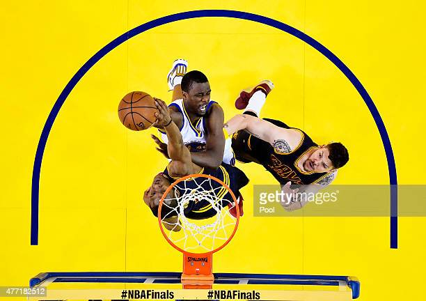 Harrison Barnes of the Golden State Warriors goes up against James Jones of the Cleveland Cavaliers in the first half during Game Five of the 2015...