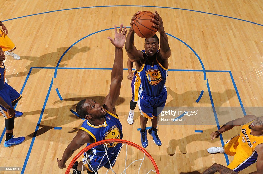 Harrison Barnes #40 of the Golden State Warriors grabs the rebound against the Los Angeles Lakers at Citizens Business Bank Arena on October 5, 2013 in Ontario, California.