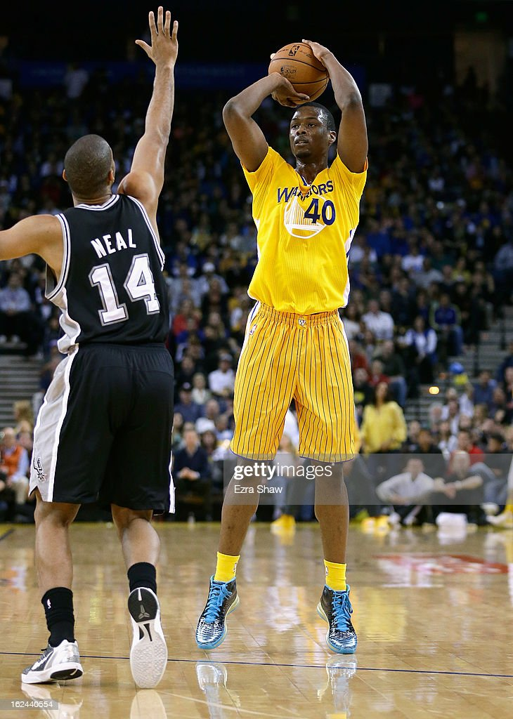Harrison Barnes #40 of the Golden State Warriors in action against the San Antonio Spurs at Oracle Arena on February 22, 2013 in Oakland, California. The Warriors are wearing new short-sleeved uniforms for the first time. The Warriors won the game in overtime.