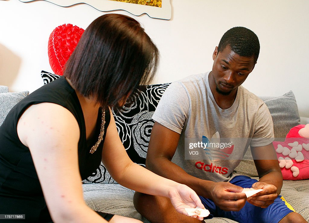 Harrison Barnes of the Golden State Warriors learns to make wonton, a type of dumpling, as he visits a fan's home on August 6, 2013 in Shanghai, China.