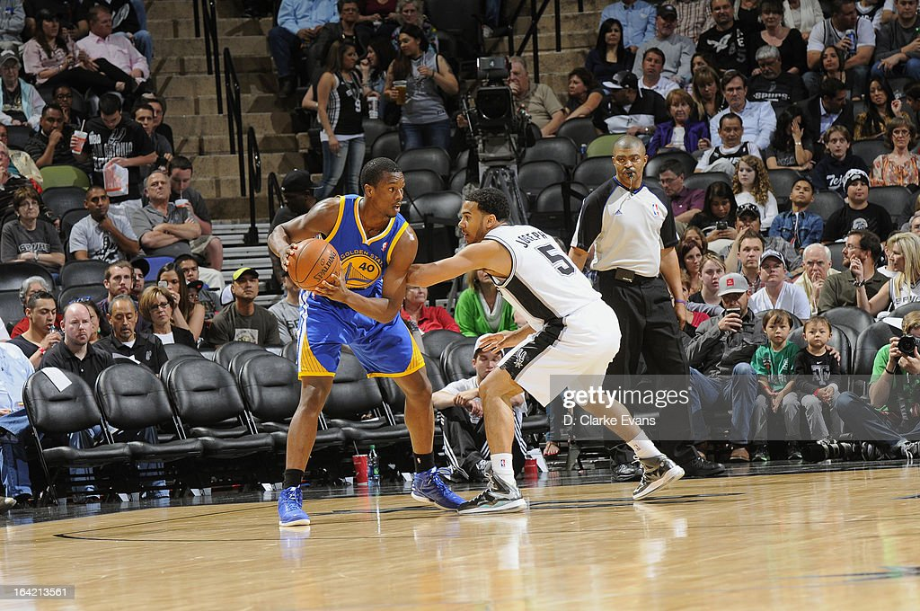Harrison Barnes #40 of the Golden State Warriors looks to pass the ball against Cory Joseph #5 of the San Antonio Spurs on March 20, 2013 at the AT&T Center in San Antonio, Texas.
