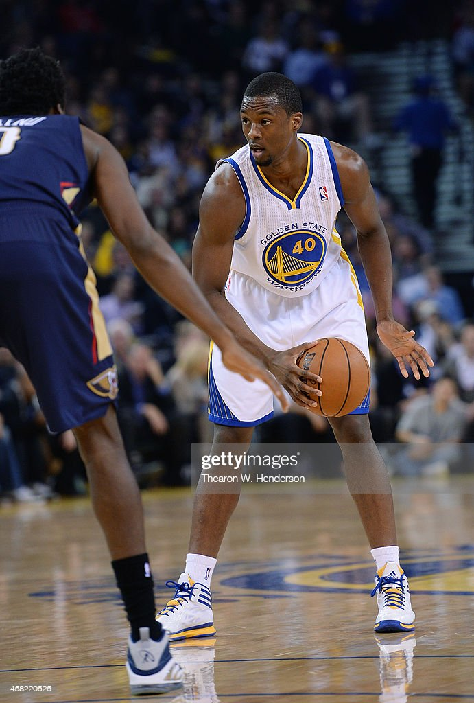 Harrison Barnes #40 of the Golden State Warriors looks to put a move on Al-Farouq Aminu #0 of the New Orleans Pelicans at ORACLE Arena on December 17, 2013 in Oakland, California.