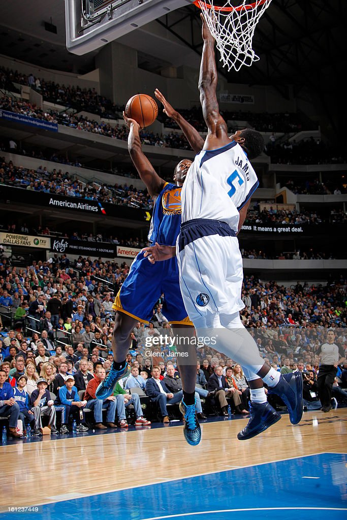 Harrison Barnes #40 of the Golden State Warriors looks to score against Bernard James #5 of the Dallas Mavericks on February 9, 2013 at the American Airlines Center in Dallas, Texas.