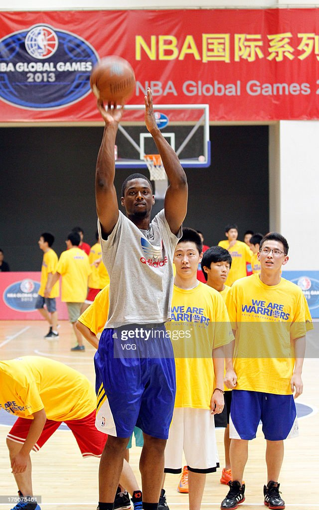 <a gi-track='captionPersonalityLinkClicked' href=/galleries/search?phrase=Harrison+Barnes&family=editorial&specificpeople=6893973 ng-click='$event.stopPropagation()'>Harrison Barnes</a> of the Golden State Warriors meets fans at Oriental Sports Center on August 6, 2013 in Shanghai, China.