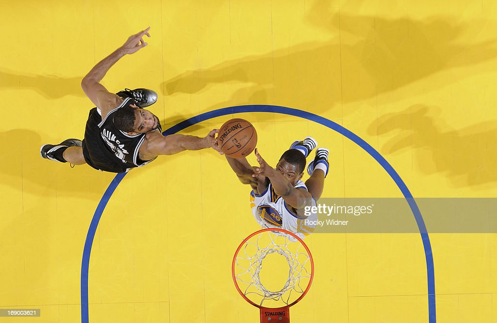 <a gi-track='captionPersonalityLinkClicked' href=/galleries/search?phrase=Harrison+Barnes&family=editorial&specificpeople=6893973 ng-click='$event.stopPropagation()'>Harrison Barnes</a> #40 of the Golden State Warriors rebounds against <a gi-track='captionPersonalityLinkClicked' href=/galleries/search?phrase=Tim+Duncan&family=editorial&specificpeople=201467 ng-click='$event.stopPropagation()'>Tim Duncan</a> #21 of the San Antonio Spurs in Game Four of the Western Conference Semifinals during the 2013 NBA Playoffs on May 12, 2013 at Oracle Arena in Oakland, California.