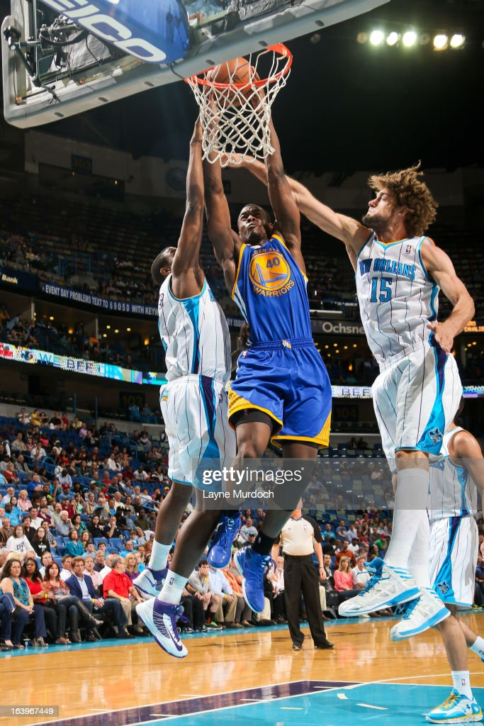 Harrison Barnes #40 of the Golden State Warriors rises for a dunk against Robin Lopez #15 of the New Orleans Hornets on March 18, 2013 at the New Orleans Arena in New Orleans, Louisiana.
