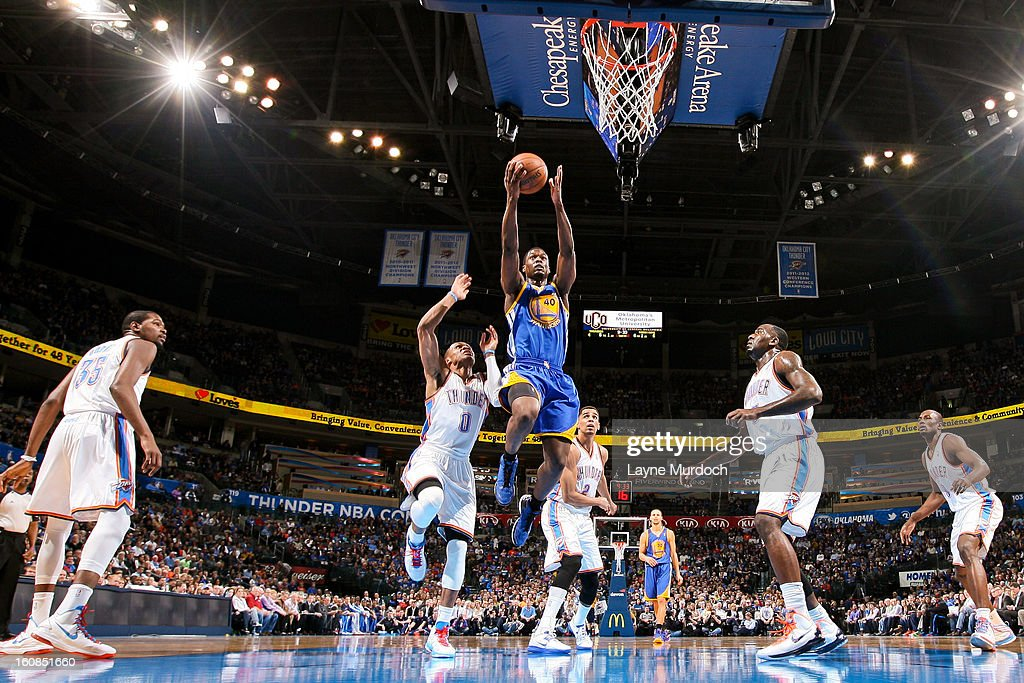 Harrison Barnes #40 of the Golden State Warriors shoots a layup against Russell Westbrook #0 of the Oklahoma City Thunder on February 6, 2013 at the Chesapeake Energy Arena in Oklahoma City, Oklahoma.