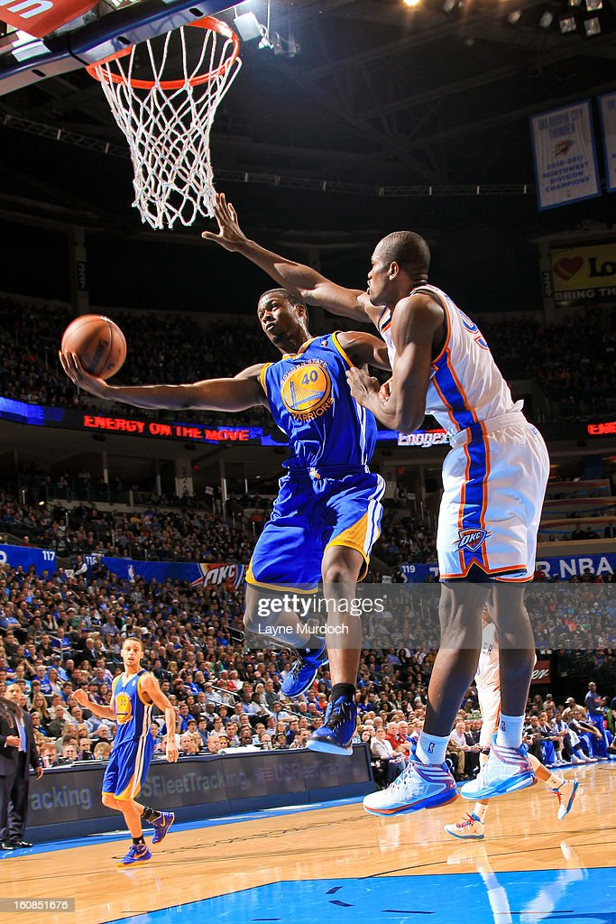Harrison Barnes #40 of the Golden State Warriors shoots a layup against Serge Ibaka #9 of the Oklahoma City Thunder on February 6, 2013 at the Chesapeake Energy Arena in Oklahoma City, Oklahoma.