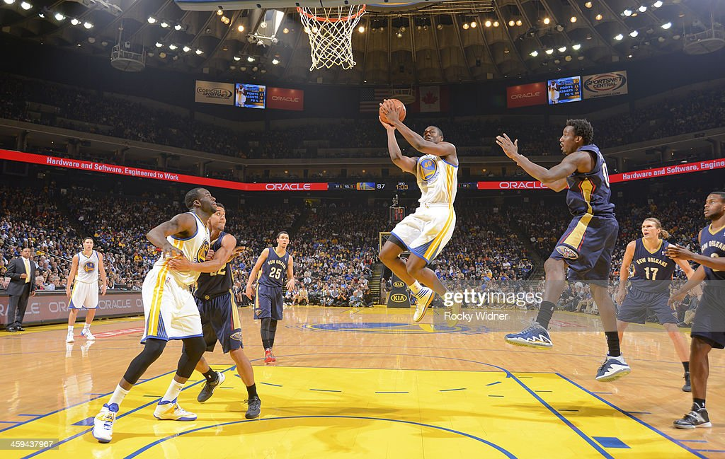 <a gi-track='captionPersonalityLinkClicked' href=/galleries/search?phrase=Harrison+Barnes&family=editorial&specificpeople=6893973 ng-click='$event.stopPropagation()'>Harrison Barnes</a> #40 of the Golden State Warriors shoots against <a gi-track='captionPersonalityLinkClicked' href=/galleries/search?phrase=Al-Farouq+Aminu&family=editorial&specificpeople=5042446 ng-click='$event.stopPropagation()'>Al-Farouq Aminu</a> #0 of the New Orleans Pelicans on December 17, 2013 at Oracle Arena in Oakland, California.