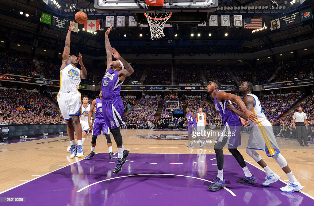 Harrison Barnes of the Golden State Warriors shoots against DeMarcus Cousins of the Sacramento Kings on October 29 2014 at Sleep Train Arena in...