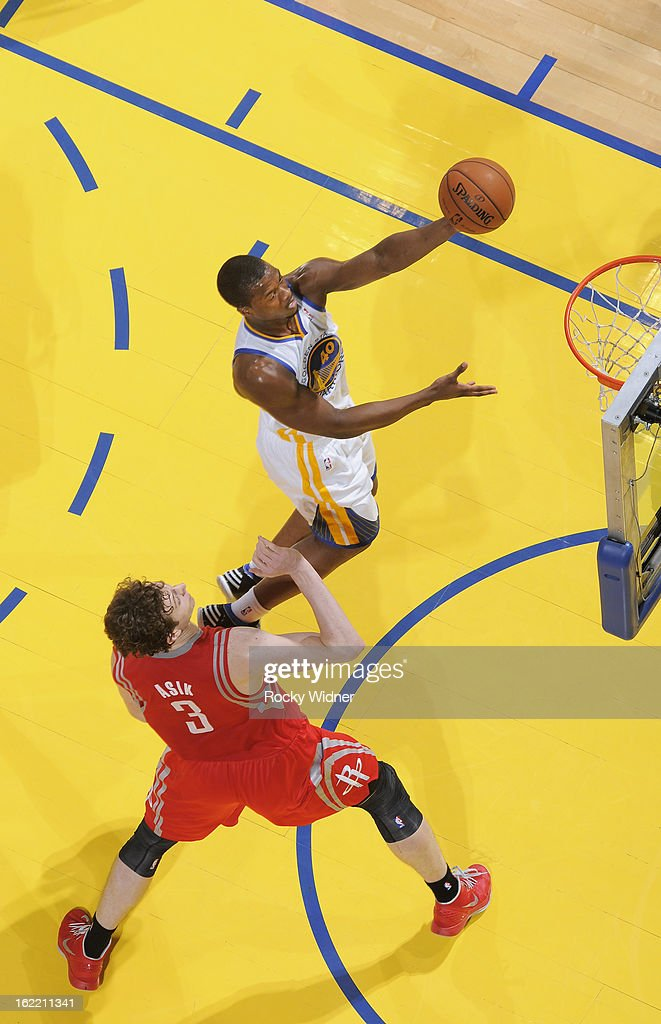 <a gi-track='captionPersonalityLinkClicked' href=/galleries/search?phrase=Harrison+Barnes&family=editorial&specificpeople=6893973 ng-click='$event.stopPropagation()'>Harrison Barnes</a> #40 of the Golden State Warriors shoots against <a gi-track='captionPersonalityLinkClicked' href=/galleries/search?phrase=Omer+Asik&family=editorial&specificpeople=4946055 ng-click='$event.stopPropagation()'>Omer Asik</a> #3 of the Houston Rockets on February 12, 2013 at Oracle Arena in Oakland, California.