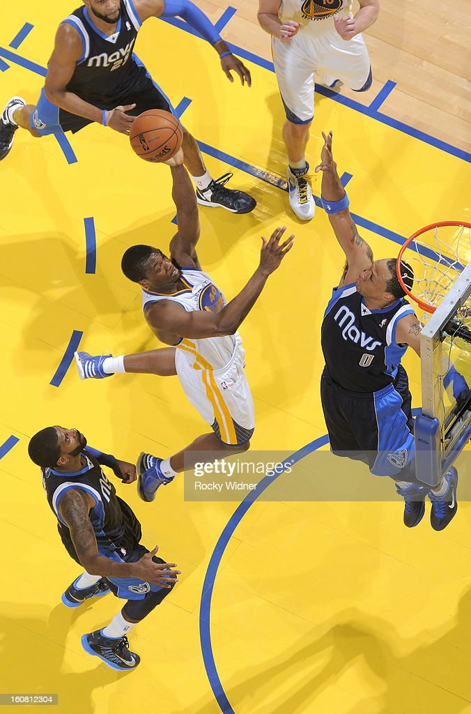 <a gi-track='captionPersonalityLinkClicked' href=/galleries/search?phrase=Harrison+Barnes&family=editorial&specificpeople=6893973 ng-click='$event.stopPropagation()'>Harrison Barnes</a> #40 of the Golden State Warriors shoots against <a gi-track='captionPersonalityLinkClicked' href=/galleries/search?phrase=Shawn+Marion&family=editorial&specificpeople=201566 ng-click='$event.stopPropagation()'>Shawn Marion</a> #0 of the Dallas Mavericks on January 31, 2013 at Oracle Arena in Oakland, California.