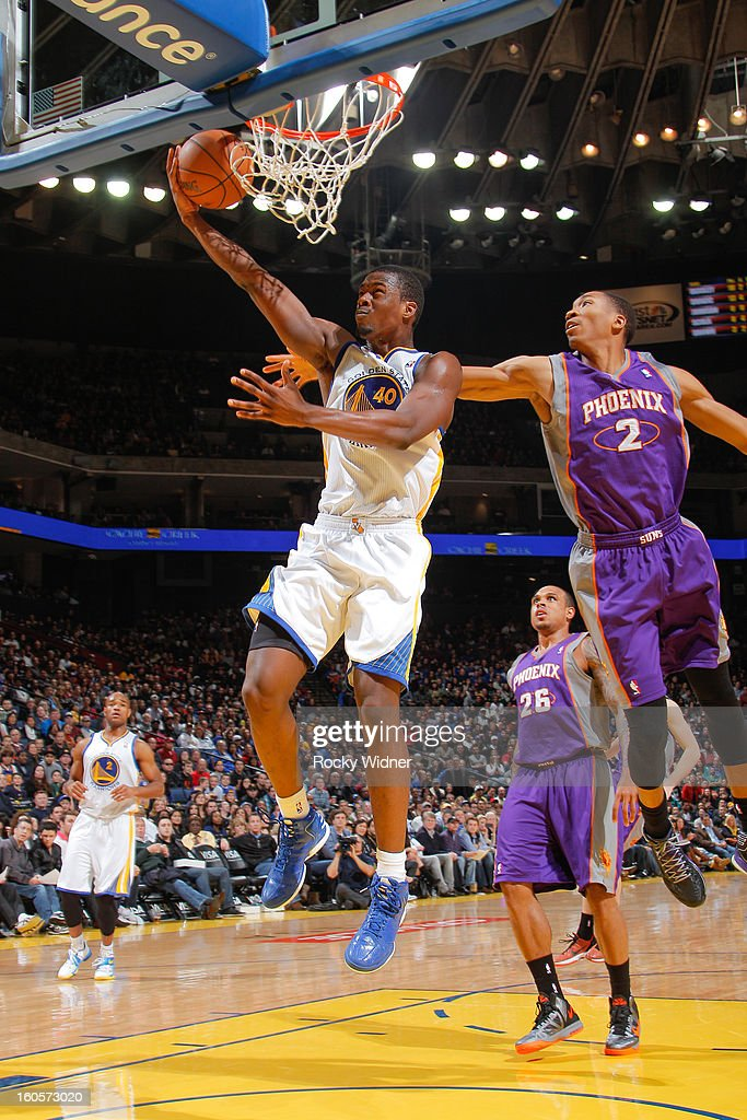 Harrison Barnes #40 of the Golden State Warriors shoots against Wesley Johnson #2 of the Phoenix Suns on February 2, 2013 at Oracle Arena in Oakland, California.