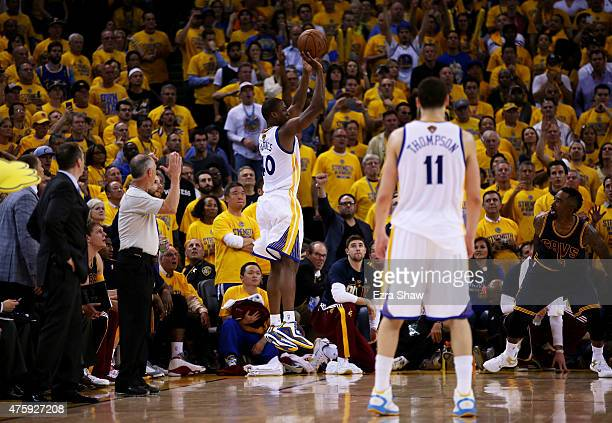 Harrison Barnes of the Golden State Warriors shoots for three in overtime against the Cleveland Cavaliers during Game One of the 2015 NBA Finals at...