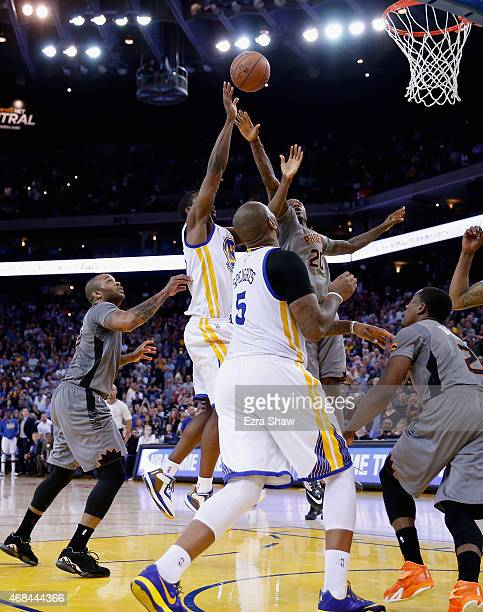 Harrison Barnes of the Golden State Warriors shoots the game winning basket in the final seconds of their game against the Phoenix Suns at ORACLE...