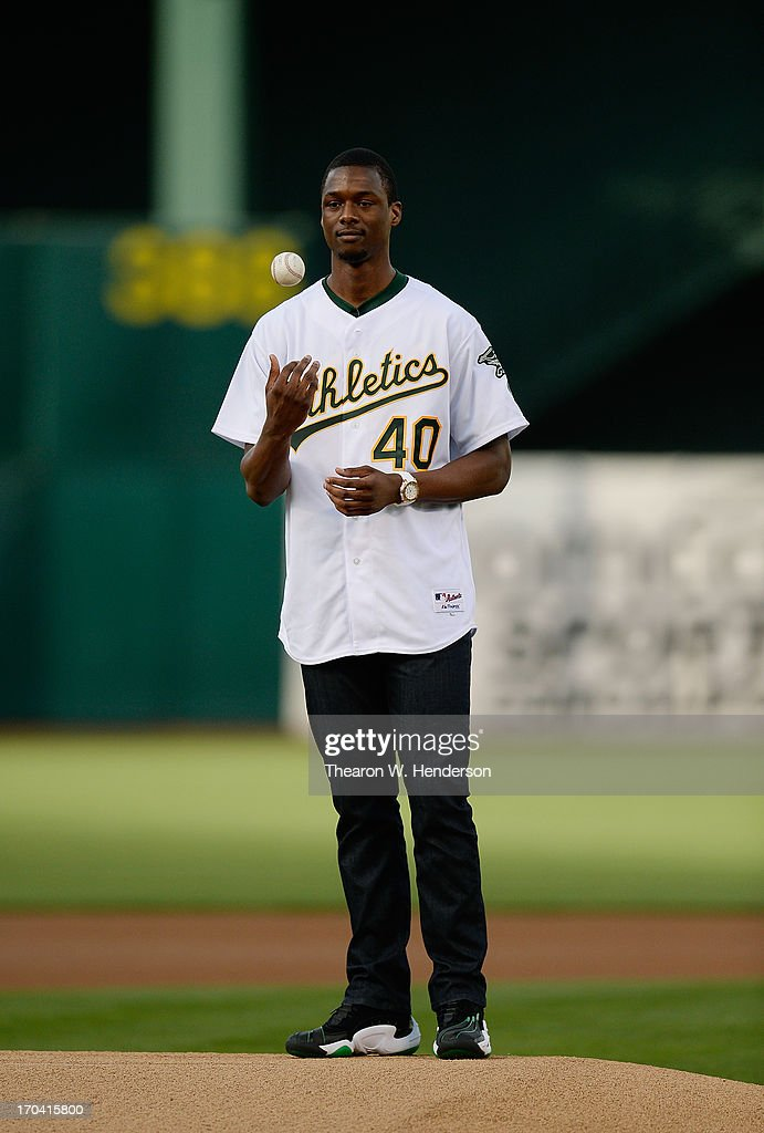 Harrison Barnes #40 of the Golden State Warriors throws out the ceramonial first pitch before a Major League Baseball game between the New York Yankees and Oakland Athletics at O.co Coliseum on June 11, 2013 in Oakland, California.