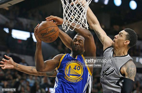 Harrison Barnes of the Golden States Warriors has his shot blocked by Kawhi Leonard of the San Antonio Spursnot visible and Danny Green of the San...