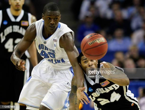 Harrison Barnes of the North Carolina Tar Heels and David Hicks of the Long Island Blackbirds battle for a loose ball in the first half during the...