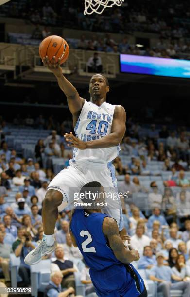 Harrison Barnes of the North Carolina Tar Heels drives to the basket over Patrick Miller of the Tennessee State Tigers during their game at Dean...