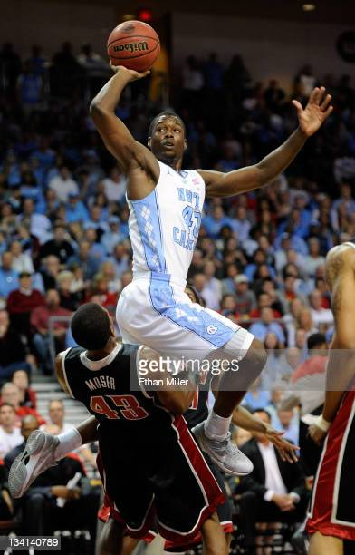 Harrison Barnes of the North Carolina Tar Heels is called for a charge as he shoots against Mike Moser of the UNLV Rebels during the championship...