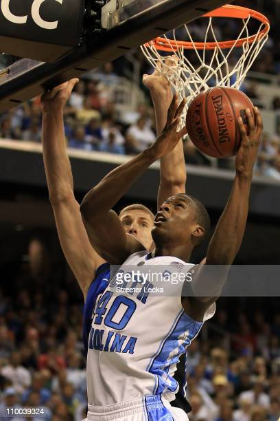 Harrison Barnes of the North Carolina Tar Heels shoots against Mason Plumlee of the Duke Blue Devils during the second half in the championship game...